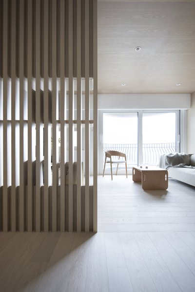 Bean Buro's Urban Cocoon draws inspiration from Japanese teahouses. This reference point can be felt at the entryway, which features light timber and slatted screens.