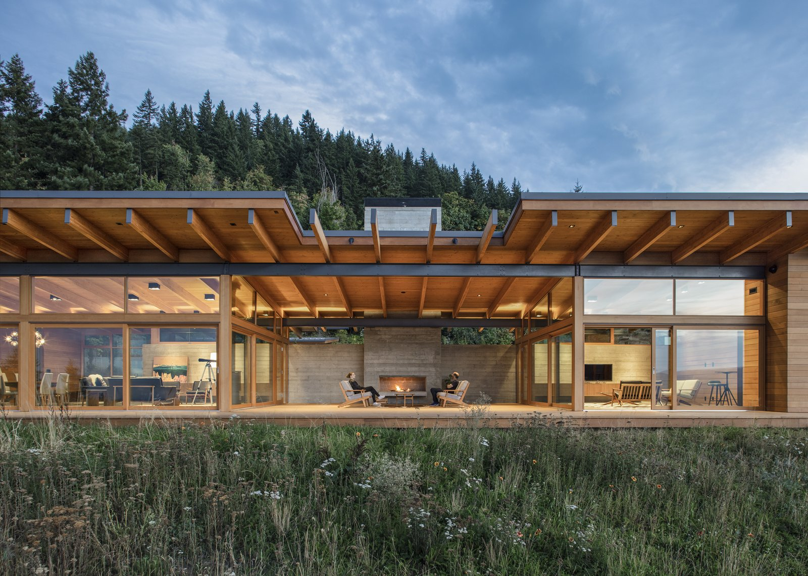 The Hood River Residence features a generous outdoor patio area that collects the public spaces of the home into one large indoor/outdoor entertaining space.