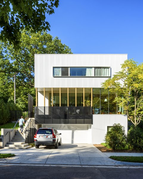 A perforated metal screen allows the family to