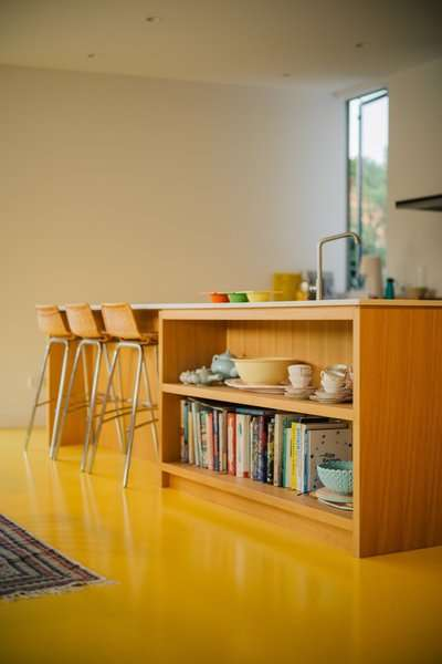 A Bright-Yellow Floor Beams New Life Into an Auckland Bungalow