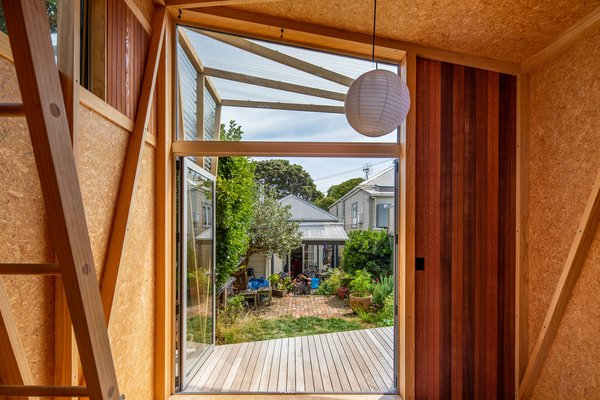 Herald Garden Studio is situated behind a two-bedroom cottage on a narrow lot in Wellington's suburb of Berhampore.