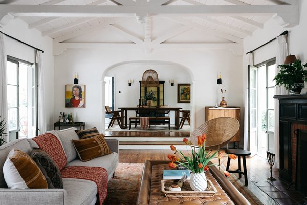 A mini-compound at 3295 Bennett Drive has allured many A-list stars throughout the years. The property occupies three lots, offering a half-acre gated oasis in the heart of the Hollywood Hills. Here, a living area in the newly renovated main residence is fitted with a bow-truss ceiling.