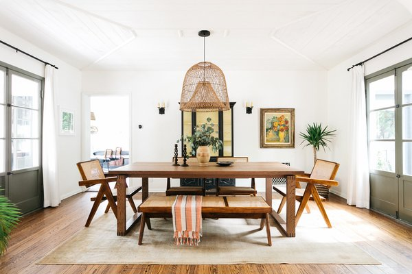 Measuring 2,957 square feet, the main dwelling flows between several living spaces. The dining area sits sandwiched between the living room and kitchen.
