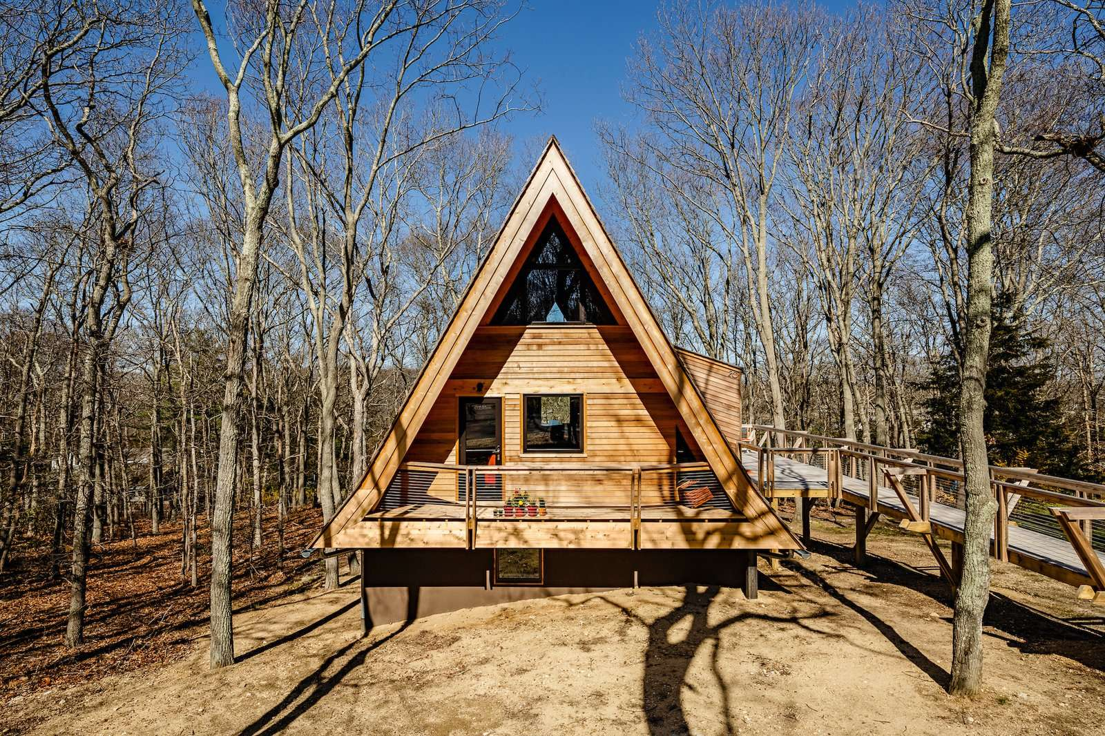 The triangular form of the 1,189-square-foot A-frame cabin, which sits in a small forest of oak trees on Long Island, has been emphasized as part of the renovation.