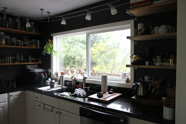 Since most of the windows face north, there was not a lot of direct sunlight, resulting in a dark interior. Storage was another concern, as the existing kitchen and bathrooms did not offer a lot of storage space.