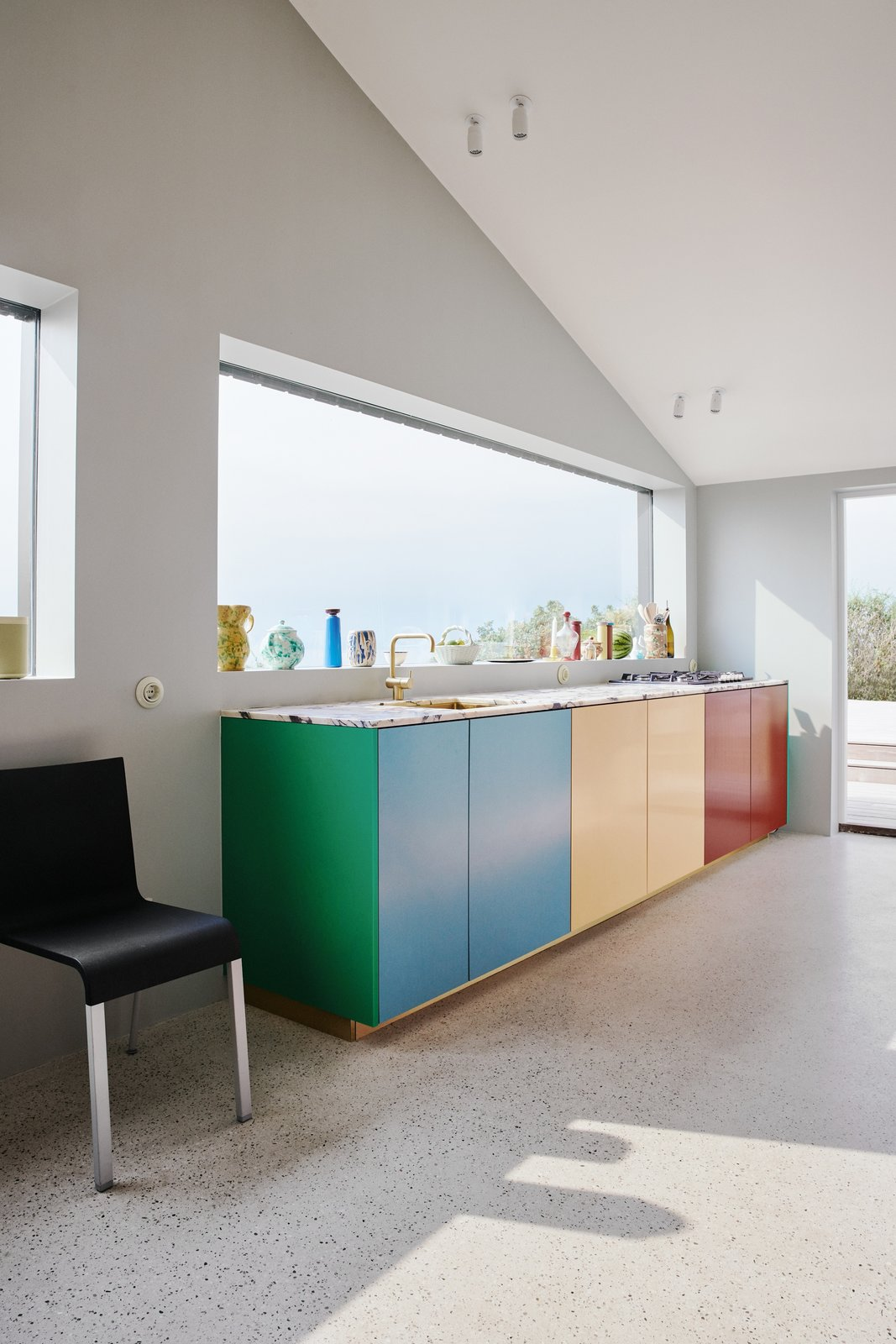 """""""It is also possible to add a separate kitchen island in a different color than the rest of the kitchen,"""" suggests Christensen."""