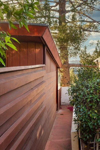 """Perched on a steep hillside in Silver Lake, the John and Mary Lautner Residence remains in nearly original condition. The redwood-clad home cascades down a steep slope—a challenge Lautner approached with the intention """"to build something of the hill, rather than in spite of the hill."""""""