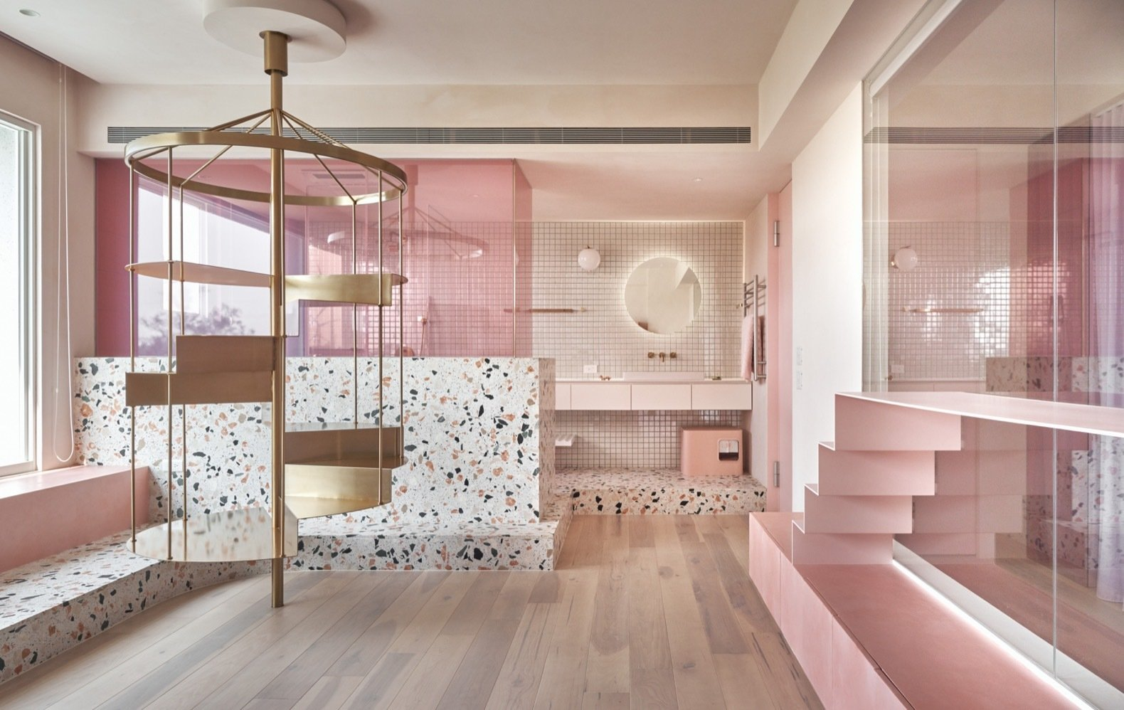 Terrazzo surfaces flecked with pink and a stainless steel mobile/staircase provide cool sleeping areas for the cats in the summertime.