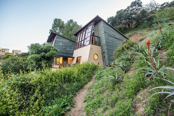 The 1938 A. Quincy Jones House & Studio was designed by the celebrated architect and his then-partner Ruth Schneider. The couple designed the home to sprout organically from the native vegetation on the western slope of L.A.'s Laurel Canyon.