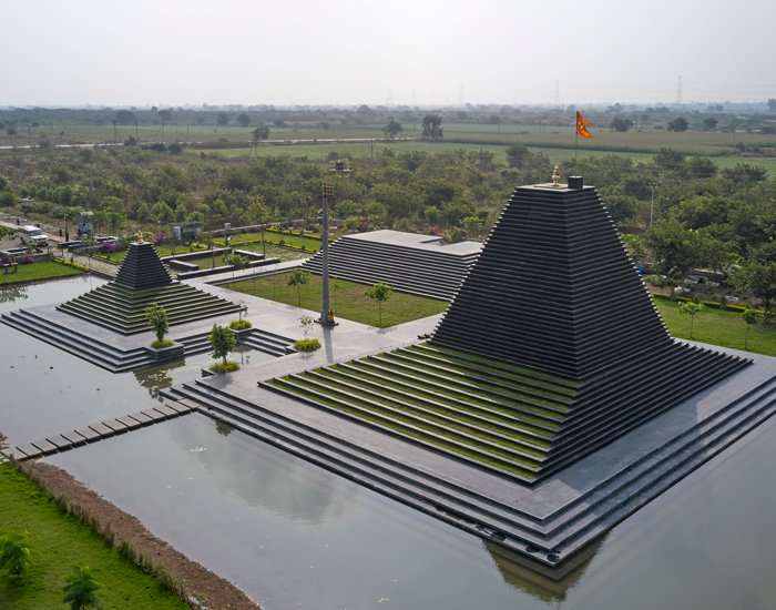 sP+a constructs temple in india with shrines made from black limestone