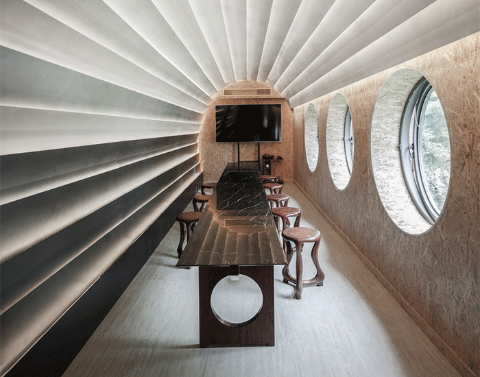 stone plates and round windows complete exhibition hall + teahouse in shanghai