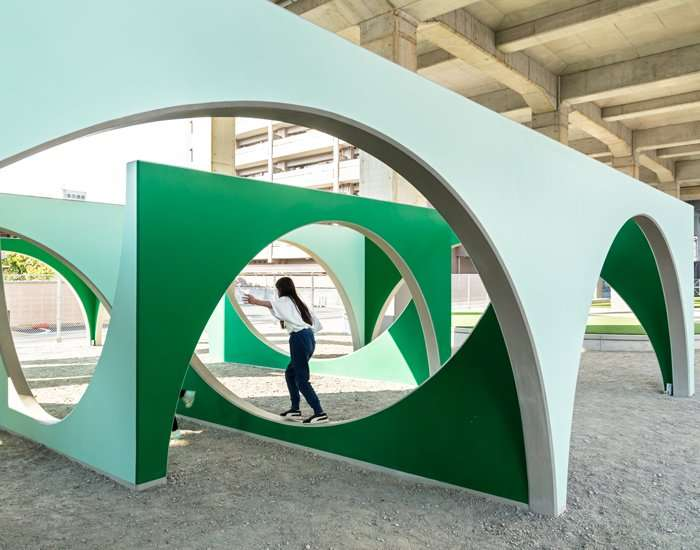 geo-graphic design lab's monto park is a playful grove of arches in osaka