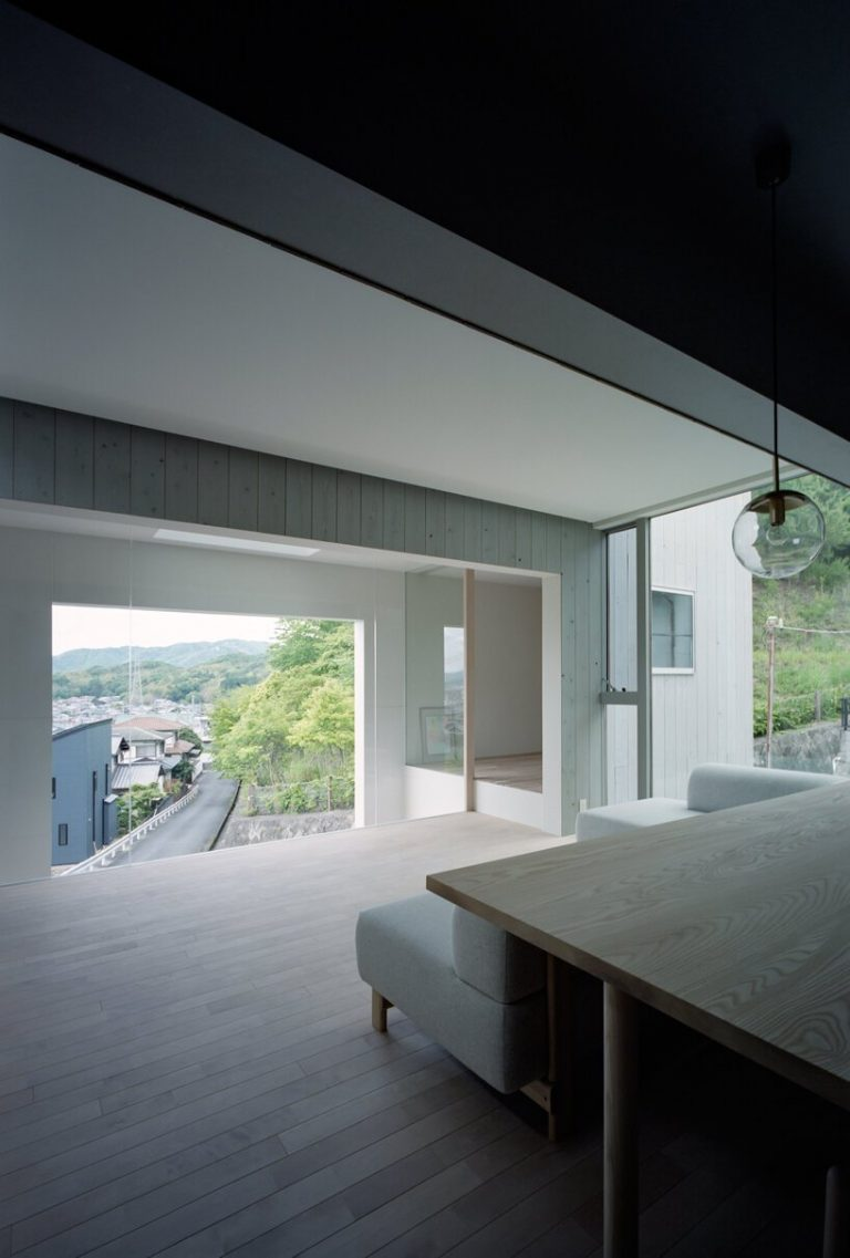 a picture frame window punctures house in himeji by fujiwaramuro architects in japan