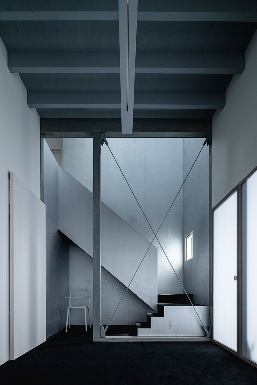 jun igarashi completes the private 'tunnel and trapezoid' house in hokkaido, japan