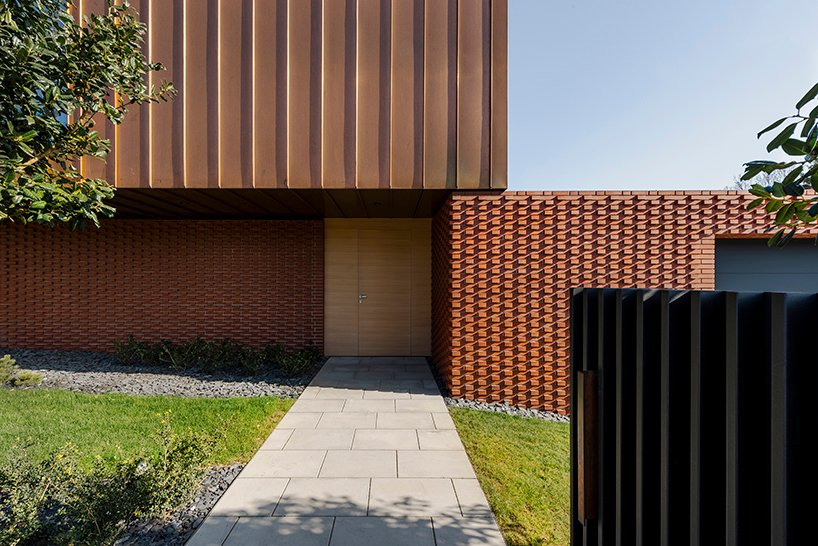 MVA architects wraps courtyard house in textured brick wall in zagreb