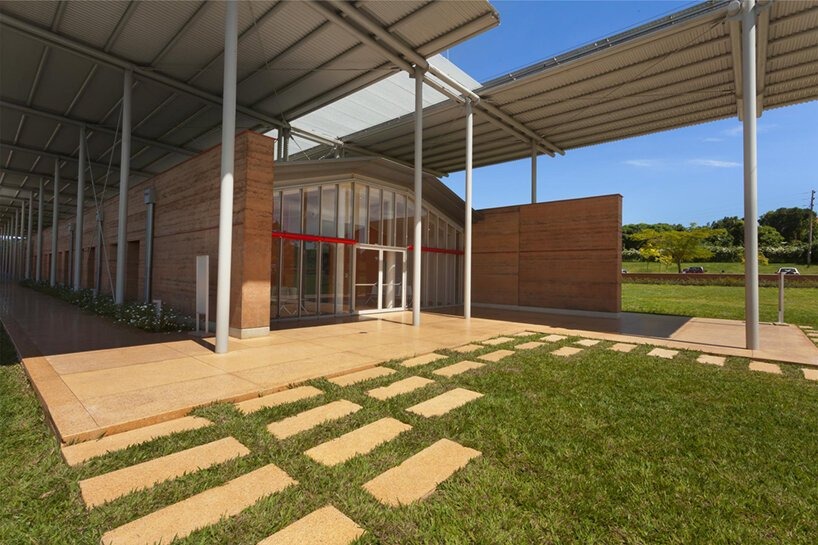 renzo piano completes children's hospital in uganda with rammed earth walls