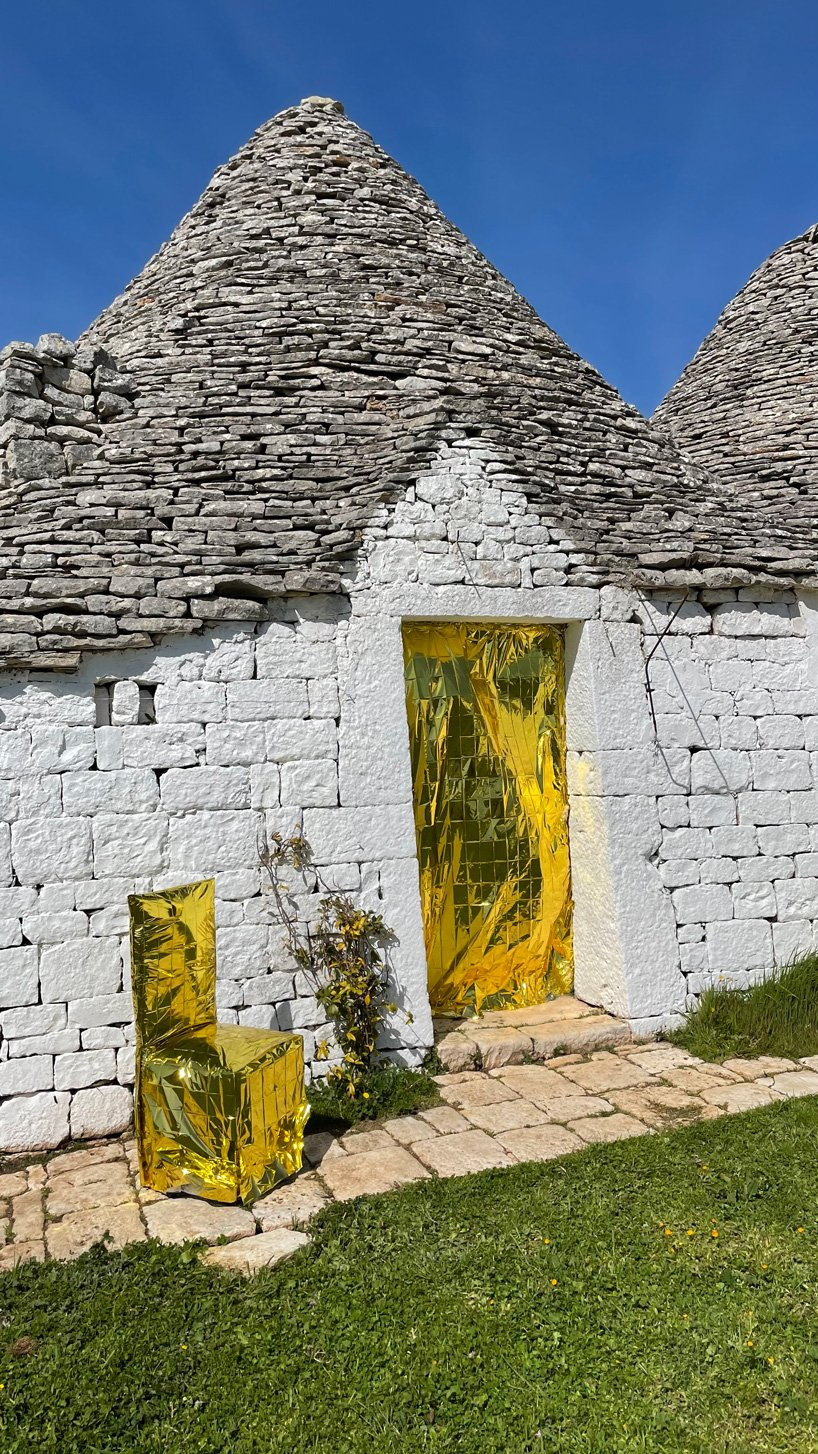 studio lievito wraps chairs in isothermal blankets for this art installation in apulia