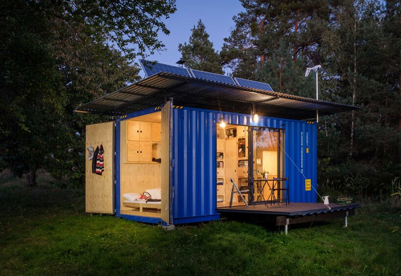 this tiny cabin made from an upcycled shipping container is completely self-sufficient