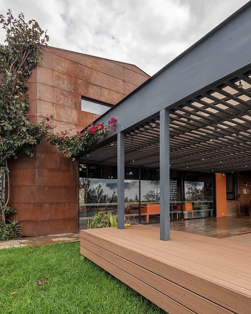 old warehouse is transformed into steel-clad modern country house in ecuador