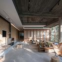 Mottled shades of trees projected into the lounge area. Image © Yilong Zhao