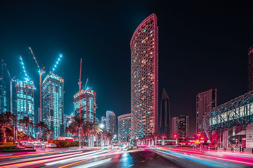 xavier portela makes dubai glow in dazzling hues and strokes of pink and blue