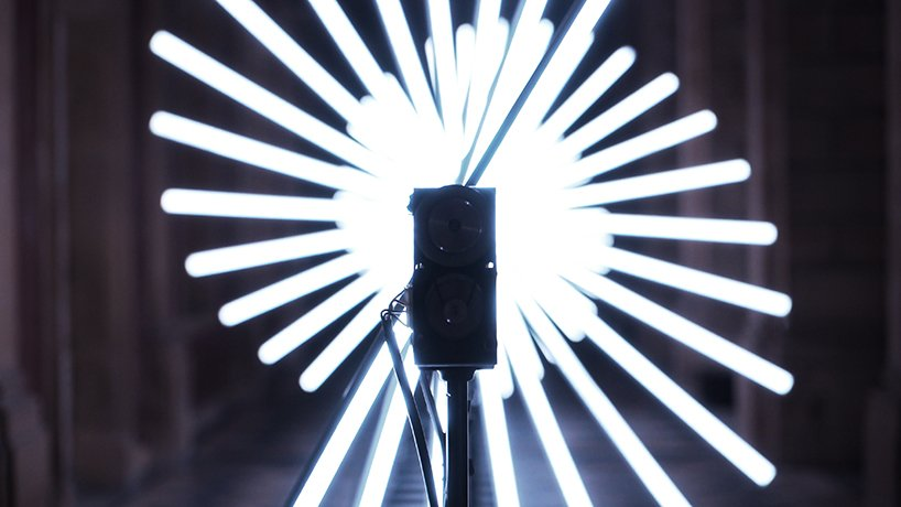 this interactive light installation reacts to music and composes kinetic poetry