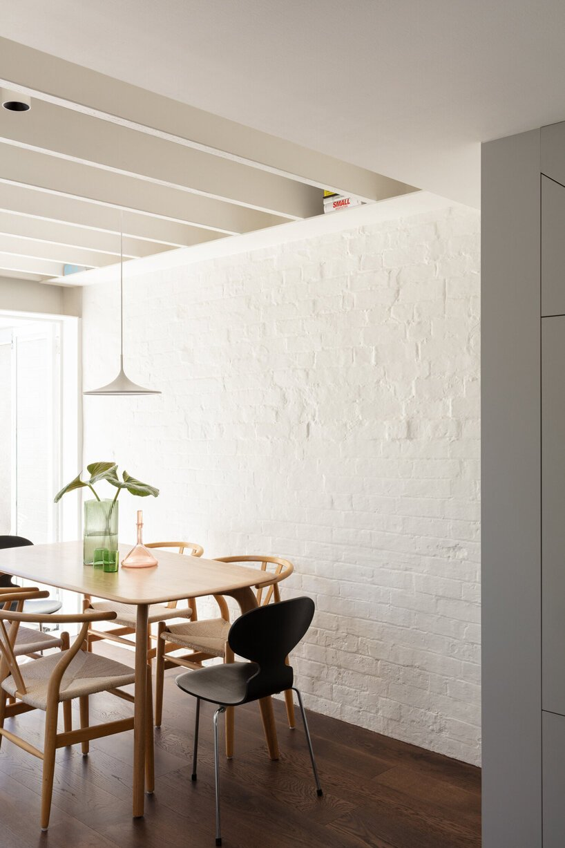 micro home nestled among busy surroundings in sydney is lightweight and simple in form