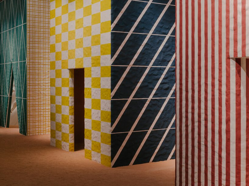 Hermès exhibits new home collections within chambers wrapped in colorful graphic patterns